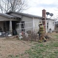 Wade Canfield, left, and Tyer Cray, both Northeast Benton County firefighters, remove equipment Tues...