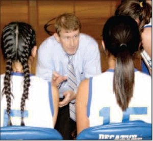 Decatur Coach Bill Niven speaks with his players courtside during a game. Niven, Decatur girls' basketball coach, came out of retirement to take over the Lady Bulldogs' program this year. This is his first season to coach girls' basketball. Niven won a state championship at Hope in 1986.