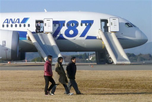 in-this-photo-taken-by-a-passenger-and-distributed-by-japans-kyodo-news-passengers-leave-an-all-nippon-airways-boeing-787-after-it-made-an-emergency-landing-at-takamatsu-airport-in-takamatsu-kagawa-prefecture-western-japan-wednesday-jan-16-2013-ana-said-a-cockpit-message-showed-battery-problems-and-a-burning-smell-was-detected-in-the-cockpit-and-the-cabin-forcing-the-787-on-a-domestic-flight-to-land-at-the-airport