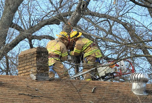 little-rock-firefighters-work-to-get-a-man-with-hernandez-tree-service-down-after-he-was-killed-by-coming-in-contact-with-electric-lines-while-trimming-tree-limbs-behind-a-house-in-the-3600-block-of-west-10th-st-around-1-pm-wednesday