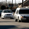 A funeral procession moves east Wednesday along West Meadow Avenue from Sisco Funeral Chapel in Spri...