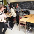 Emily Poole, left, moves to lock and cover the classroom door Wednesday as her third-period class mo...