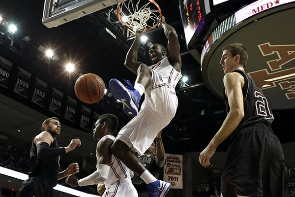 Florida's Patric Young (4) dunks the ball as Texas A&M's Alex Caruso (21) watches during the second half of an NCAA college basketball game on Thursday, Jan. 17, 2013, in College Station, Texas. Florida defeated Texas A&M 68-47. (AP Photo/David J. Phillip)