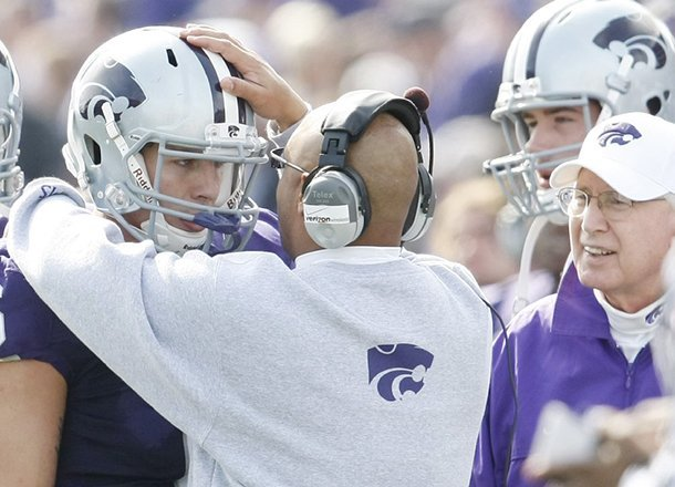 wide-receivers-coach-michael-smith-talks-with-kansas-state-quarterback-grant-gregory-on-the-sideline-during-a-2009-game-against-colorado