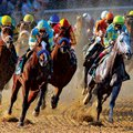 Horses race through the turn during the ÿrst race Thursday at Oaklawn Park in Hot Springs. It was th...