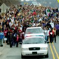 Martin Luther King Jr. is remembered in a previous march up Dickson Street in observance of Martin L...