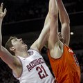 Arkansas' Hunter Mickelson (21) attempts to rebound against Auburn's Rob Chubb (41) during the secon...