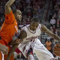 Arkansas' BJ Young, right, dribbles to the basket against Auburn's Josh Wallace during the second ha...