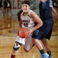Karen Perez, a Springdale junior, drives to the basket against Springdale Har-Ber during Tuesday's g...