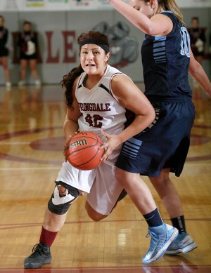 Karen Perez, a Springdale junior, drives to the basket against Springdale Har-Ber during Tuesday's game at Springdale High.