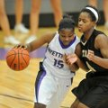 Denesha White of Fayetteville tries get past Little Rock Central defender Jamie Ruffin during the La...