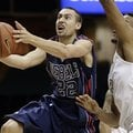 Mississippi guard Marshall Henderson (22) drives past Vanderbilt guard Kevin Bright, right, in the f...