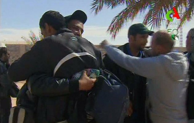 rescued-hostages-hug-each-other-in-ain-amenas-algeria-in-this-image-taken-from-television-friday-jan-18-2013