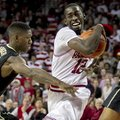 Arkansas' Fred Gully III (12) drives to the basket against Vanderbilt's Dai-Jon Parker (24) during t...