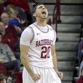 Arkansas' Kikko Haydar (20) celebrates after an Arkansas basket during the second half an NCAA colle...