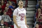 Arkansas' Kikko Haydar (20) celebrates after an Arkansas basket during the second half an NCAA college basketball game in Fayetteville, Ark., Saturday, Jan. 12, 2013. Arkansas defeated Vanderbilt 56-33. (AP Photo/Gareth Patterson)