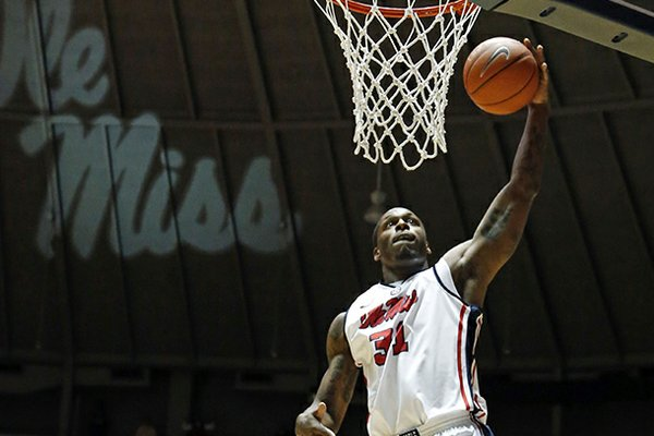 Mississippi's Murphy Holloway (31) dunks the ball in a game against Arkansas at Tad Smith Coliseum in Oxford, Miss., on Saturday, Jan. 19, 2013. (AP Photo/Oxford Eagle, Bruce Newman)
