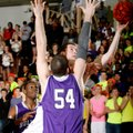 Alex Scharlau, a Springdale senior, tries to get a layup around the defense of Fayetteville senior T...
