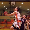 Gravette junior forward Terence Pierce attempts two under the basket, guarded by Gentry senior Robbi...