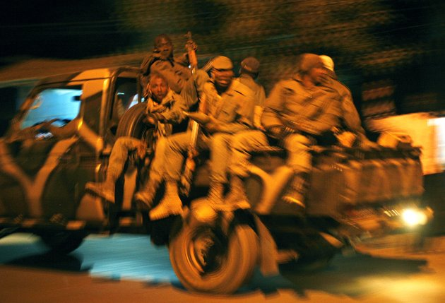 malian-soldiers-jubilate-as-they-return-to-niono-from-diabaly-some-400-kms-300-miles-north-of-the-capital-bamako-saturday-jan-19-2013-french-troops-encircled-a-key-malian-town-on-friday-trying-to-stop-radical-islamists-from-striking-against-communities-closer-to-the-capital-and-cutting-off-their-supply-line-a-french-official-said-the-move-around-diabaly-came-as-french-and-malian-authorities-said-that-the-city-whose-capture-prompted-the-french-military-intervention-in-the-first-place-was-no-longer-in-the-hands-of-the-extremists
