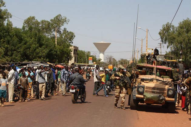 residents-of-san-in-central-mali-gather-to-look-on-as-french-troops-pass-through-en-route-to-sevare-mali-friday-jan-18-2013-french-forces-encircled-a-key-malian-town-on-friday-to-stop-radical-islamists-from-striking-closer-to-the-capital-a-french-official-said-the-move-to-surround-diabaly-came-as-french-and-malian-authorities-said-they-had-retaken-konna-the-central-city-whose-capture-prompted-the-french-military-intervention-last-week