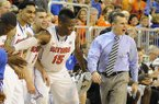 Florida coach Billy Donovan, right, shouts to his team as the clock runs down during the second half against Missouri, as his bench celebrates during an NCAA college basketball game in Gainesville, Fla., Saturday, Jan. 19, 2013. Florida won 83-52. It was Donovan's 400th career coaching win at Florida. (AP Photo/Phil Sandlin)