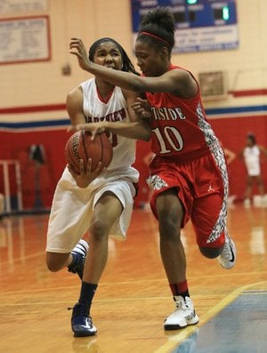 Little Rock Parkview's Christyal Holloway (left) tries to get past Fort Smith Northside defender Brianna Jackson (10) during the Lady Patriots' 57-55 victory over the Lady Grizzlies on Friday at Charles Ripley Arena in Little Rock. Holloway and Jackson ÿnished with eight points each.
