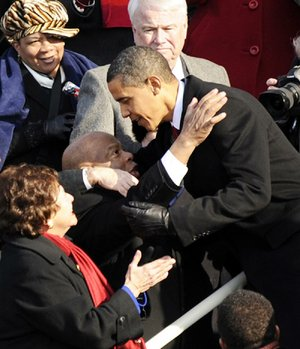 President Barack Obama greets civil-rights activist Rep. John Lewis, D-Ga., on the Capitol steps before taking the oath of office for his first term Jan. 20, 2009, in Washington.
