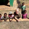 Doug Sarver, minister of global missions at Cross Church, poses with children at Esther's House orph...
