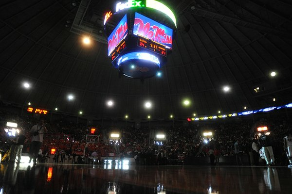 "The overhead scoreboard and emergency lights illuminate the court after the main lights went out at the main lights at the C.M. ""Tad"" Smith Coliseum during the first half of an NCAA college basketball game between Arkansas and Mississippi in Oxford, Miss., on Saturday, Jan. 19, 2013. (AP Photo/Oxford Eagle, Bruce Newman)"