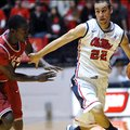 Mississippi's Marshall Henderson (22) drives against Arkansas' Fred Gulley (12) during an NCAA colle...
