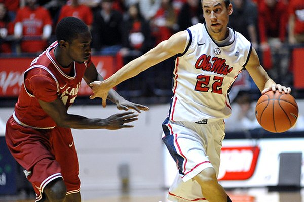 Mississippi's Marshall Henderson (22) drives against Arkansas' Fred Gulley (12) during an NCAA college basketball game in Oxford, Miss. on Saturday, Jan. 19, 2013. (AP Photo/Oxford Eagle, Bruce Newman)