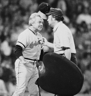 "Baltimore Orioles Manager Earl Weaver ""flips his lid"" as he protests a call by home plate umpire Marty Springstead during a game against the Chicago White Sox on July 13, 1974. Weaver, the fiery Hall of Fame manager who won 1,480 games with the Baltimore Orioles, died Saturday. He was 82."