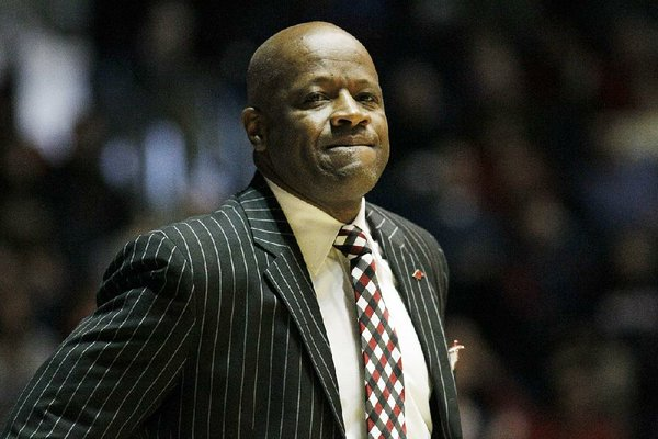 Arkansas coach Mike Anderson shows frustration during the second half of an NCAA college basketball game against Mississipppi, Saturday, Jan. 19, 2013, in Oxford, Miss. Mississippi won 76-64. (AP Photo/Rogelio V. Solis)