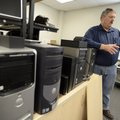 Schumacher stands next to a row of computers Friday that will be used by the Benton County Sheriff's...