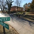 A pedestrian walks north Wednesday on Duncan Avenue to Center Street in Fayetteville past a house an...