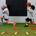 Mandy Parker, left, 10, and her brother, Manuel Parker, 6, both of Wesley, do lunges while working o...