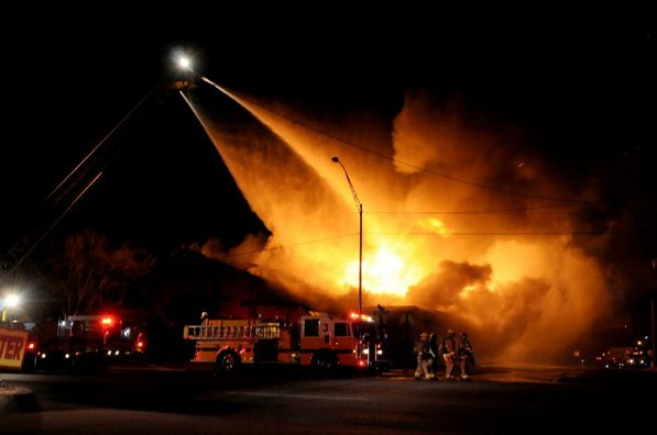 Photo by Anthony Reyes—                                                                                        Springdale firefighters respond to a fire at an abandoned church Sunday, Jan. 20, 2013 on the north east corner of Grove Avenue and Thompson Street in Springdale.