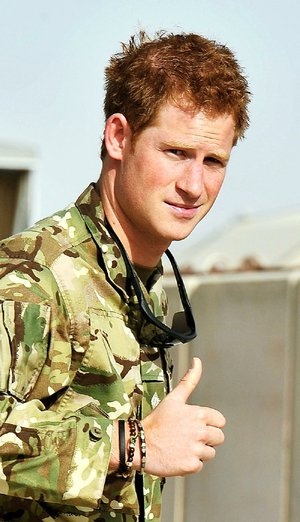 Britain's Prince Harry gives a thumbs up Friday Sept. 7, 2012 after he walked past the Apache flight-line at Camp Bastion in Afghanistan.