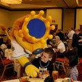 Lucas McDaniel, 10, of Springdale tries to keep Sluggerrr, the Kansas City Royals mascot, out of his...
