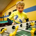 Ethan Enlow, 8, of Bentonville plays table soccer with friends Monday inside the Boys & Girls Club i...