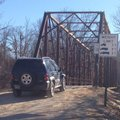 A vehicle drives southbound Monday onto the Harvey Dowell Bridge on Washington County Road 195. Coun...
