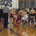 MARK HUMPHREY STAFF PHOTO -- Lincoln's Bailey Heffley is pressured in the corner by Prairie Grove's ...