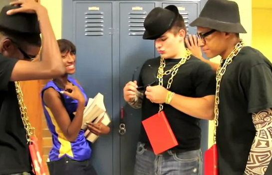 a-screen-grab-from-a-north-little-rock-high-school-video-promoting-literacy-shows-students-wearing-books-on-gold-chains-around-their-necks
