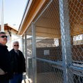 Steve Milligan, left, and Randy Ward, both with Modern Fence & Supply in Springdale, look over one o...