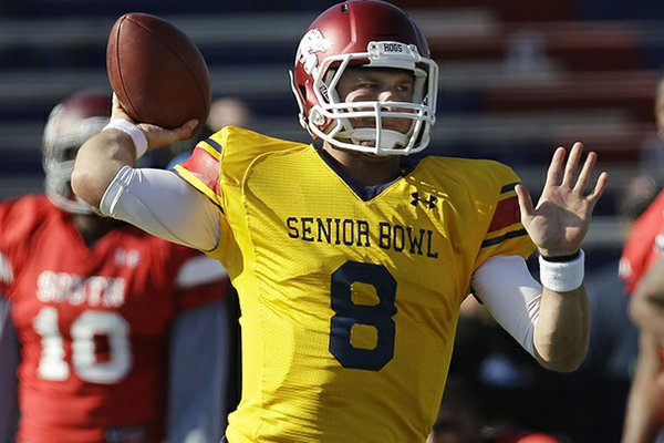 Senior Bowl South Squad quarterback Tyler Wilson of Arkansas (8) throws a pass during Senior Bowl football practice at Ladd-Peebles Stadium in Mobile, Ala., Tuesday, Jan. 22, 2013. (AP Photo/Dave Martin)