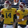 Senior Bowl South Squad quarterback Landry Jones of Oklahoma (14) and quarterback Tyler Wilson of Ar...