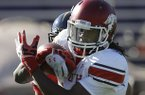 Senior Bowl South Squad wide receiver Cobi Hamilton of Arkansas catches a pass during Senior Bowl football practice at Ladd-Peebles Stadium in Mobile, Ala., Tuesday, Jan. 22, 2013. (AP Photo/Dave Martin)