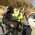 Carole Jones of Fayetteville looks through a spotting scope at waterfowl on Beaver Lake during a Nor...