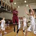 Tereke Eckwood, Springdale High, puts a shot up Tuesday in front of Bentonville's Austin Haggard, ce...